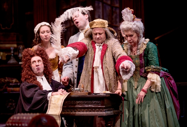 Crispin (Cliff Saunders, at center) impersonates Geronte to sign the will, witnessed by (from left to right) Scruple (Patrick Kerr), Lisette (Jessie Fisher), Eraste (Nate Burger) and Madame Argante (Linda Kimbrough).