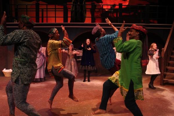 Emerson Steele as Sara and the ensemble