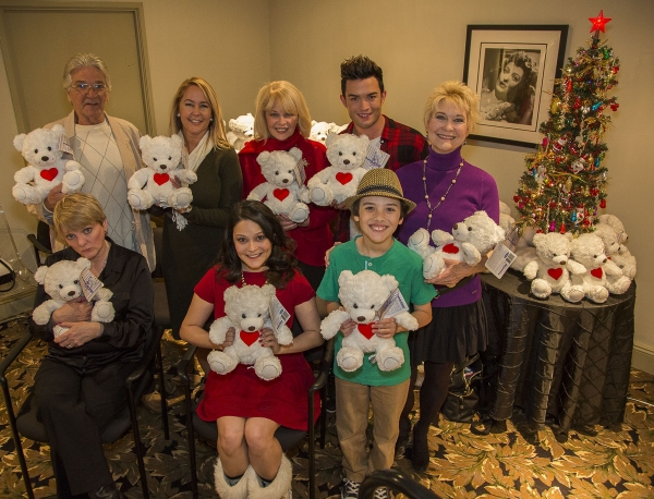 Alison Arngrim, Paul Petersen, Erin Murphy, Romi Dames, Ilene Graff, Chris Trousdale, Hunter Payten and Dee Wallace display the BuppalaPaloo Bears to be handed out to students