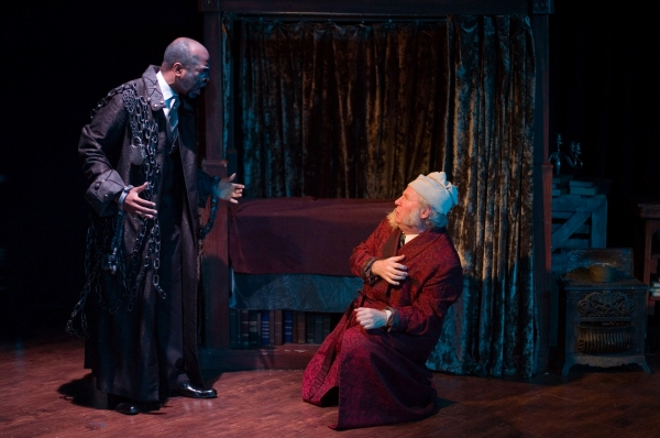 Marcus Denard Johnson as Jacob Marley and Michael Selkirk as Ebenezer Scrooge.