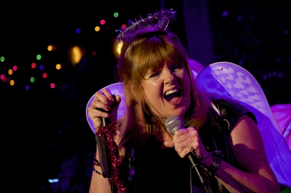 Annie Golden as the Rock and Roll Christmas Angel