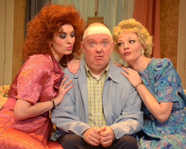 John Smith (Eddie Curry), center, seems like an ordinary cab driver, but he''s leading a double life in Beef & Boards Dinner Theatre''s production of Run for Your Wife. Married to both Barbara (Erin Cohenour), left, and Mary (Sarah Hund), right, John has