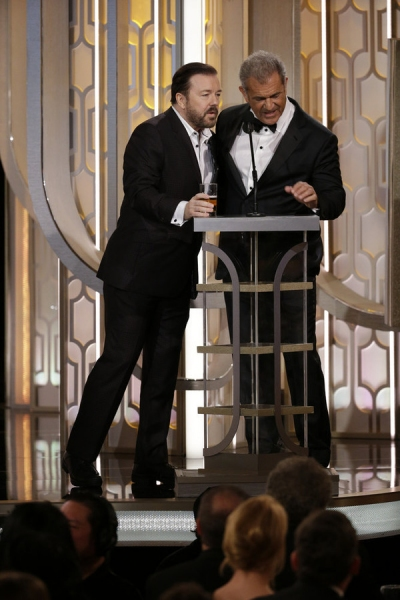 73rd ANNUAL GOLDEN GLOBE AWARDS -- Pictured: (l-r) Ricky Gervais, Host; Mel Gibson, Presenter at the 73rd Annual Golden Globe Awards held at the Beverly Hilton Hotel on January 10, 2016 -- (Photo by: Paul Drinkwater/NBC)