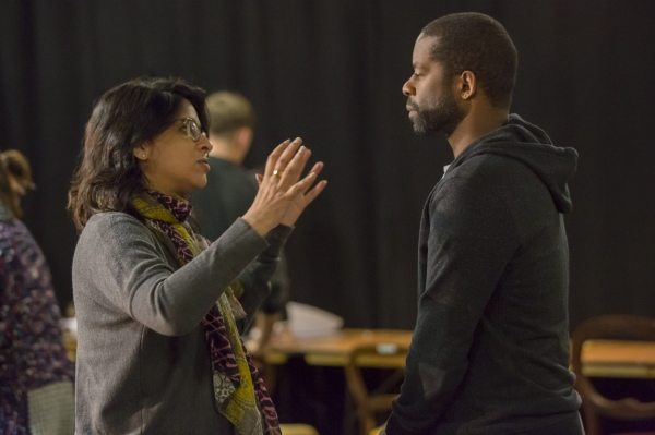 Indhu Rubasingham () and Adrian Lester (Ira)