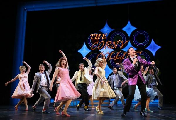 Baltimore TV host Corny Collins (Devin DeSantis, front, right) leads his Corny Collins Council Members in a dance