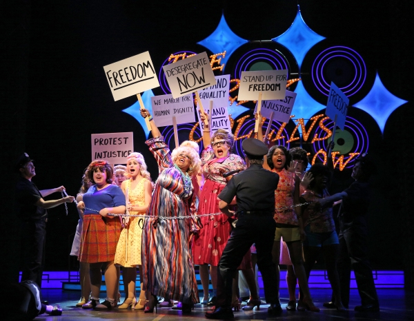 (behind chain, front, from left) Amelia Jo Parish plays Tracy Turnblad, Samantha Pauly is Amber Von Tussle, E. Faye Butler plays Motormouth Maybelle and Michael Kingston is Edna Turnblad