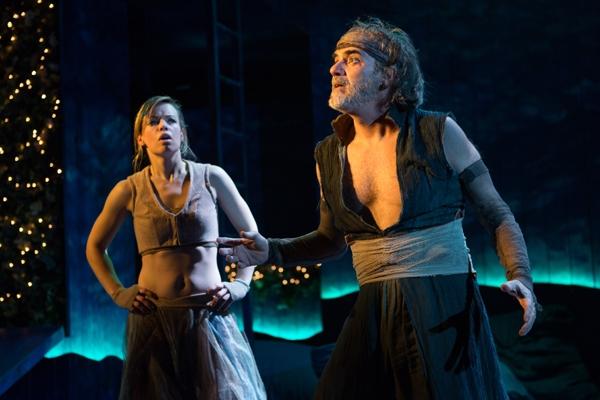 Puck (Erin Weaver) listening carefully to Oberonâ€s (Eric Hissom) mischievous plans in Shakespeareâ€s A Midsummer Nightâ€s Dream.