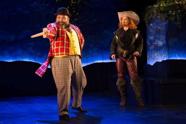 Bottom (Holly Twyford) looks on as Peter Quince (Richard Ruiz) surprisingly takes center stage
