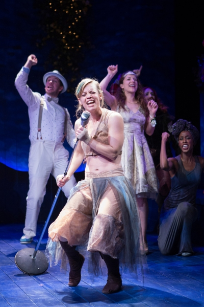 Puck (Erin Weaver) sings front and center, with Lysander (Adam Wesley Brown), Hermia (Betsy Mugavero), Bottom (Holly Twyford), and Snout (Monique Robinson) singing along in A Midsummer Nightâ€s Dream.
