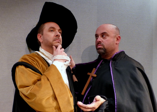 Dr. Carrasco seeks advice from the Padre. — with Daniel Kruger and Peter Miller.