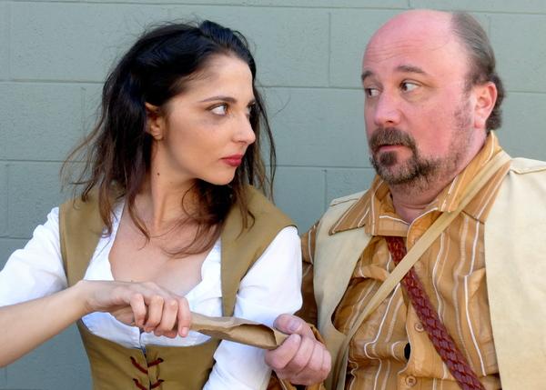 Sancho delivers a missive to Aldonza from Don Quixote De La Mancha. — with Rachel Berman and Bradley Miller.