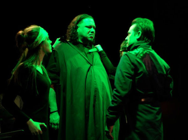 Julia Bartoletti as Chorus, Jason Quinn as Aaron, and Aaron Morris as Lucius