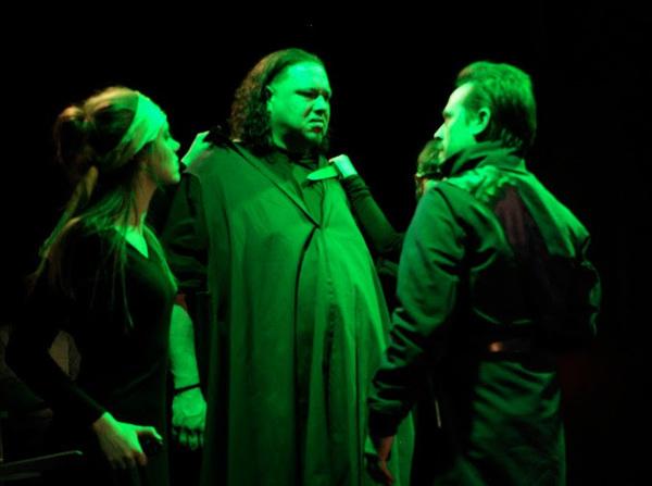 Julia Bartoletti as Chorus, Jason Quinn as Aaron, and Aaron Morris as Lucius