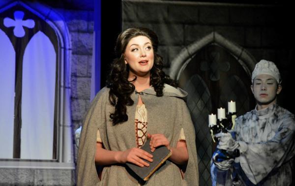 Beauty (Kaitlyn Baldwin) explores the Beast''s castle