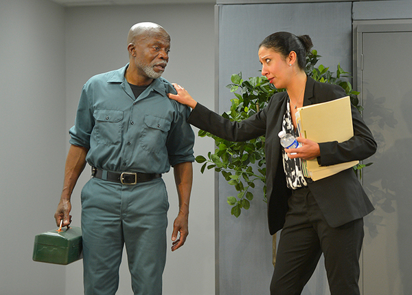 Walter (L. Peter Callender) and Charlene (Sarah Nina Hayon) conversing in the break room.