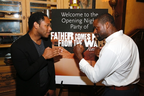 """From left, cast members Larry Powell and Sterling K. Brown pose during the party for the opening night performance of """"Father Comes Home From The Wars (Parts 1, 2 & 3)"""" at Center Theatre Group/Mark Taper Forum on Sunday, April 17, 2016, in Los Angeles, Ca"""