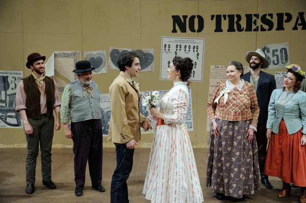 Charlie Thurston as Curly and Rachael Warren as Laurey (center) with the cast of OKLAHOMA!