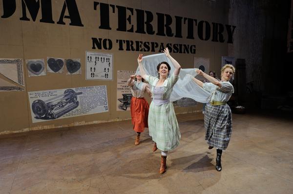 Rachael Warren as Laurey (center) and ensemble members Hannah Spacone and Shura Barys Photo