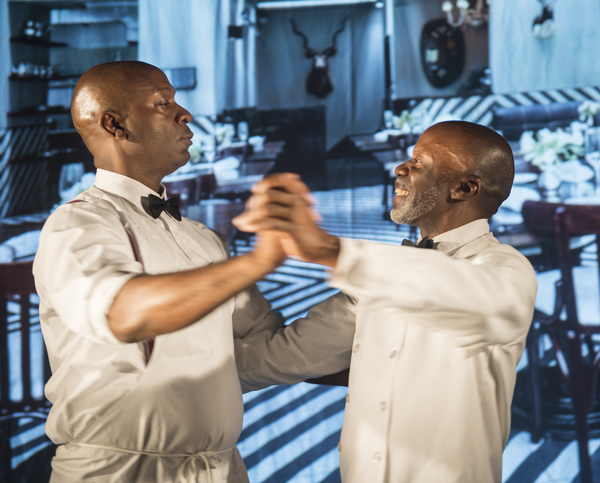 Willie (Adrian Roberts) and Sam (L. Peter Callender) practice ballroom dancing