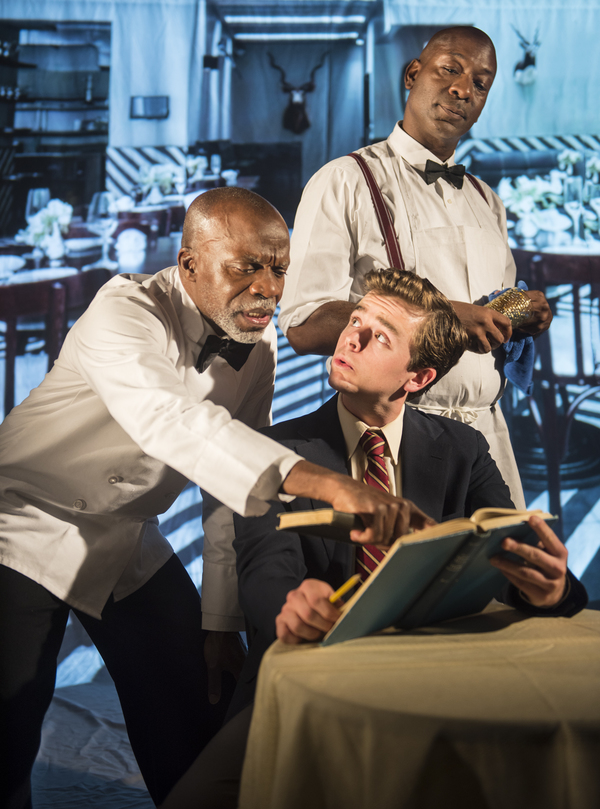 Sam (L. Peter Callender) does homework with Hally (Andrew Humann) as Wille (Adrian Roberts) looks on