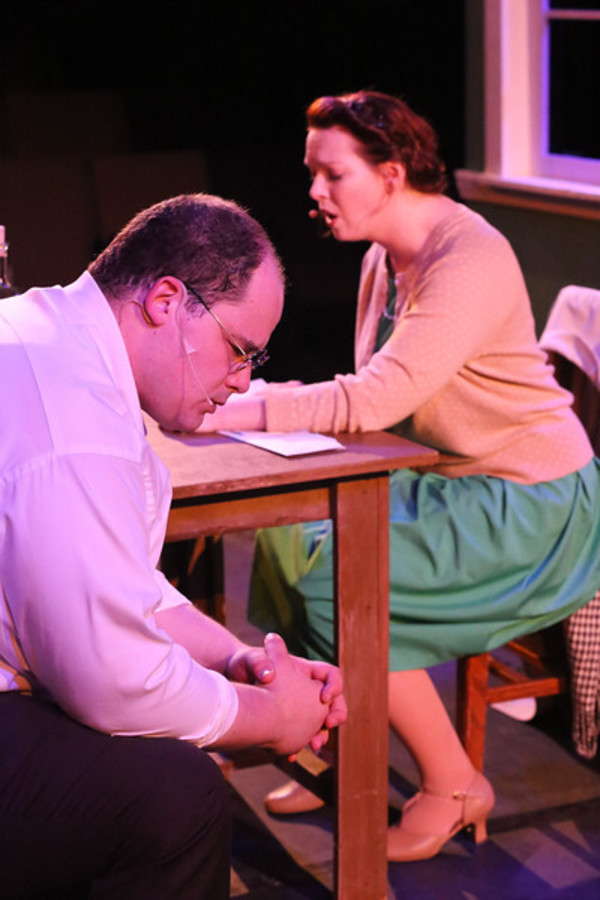"Zachary Allen Farmer as Leo Szilard and Ann Hier as Trude Weiss, singing ""Where is Home?"", in New Line Theatre's ATOMIC. Photo credit: Jill Ritter Lindberg."