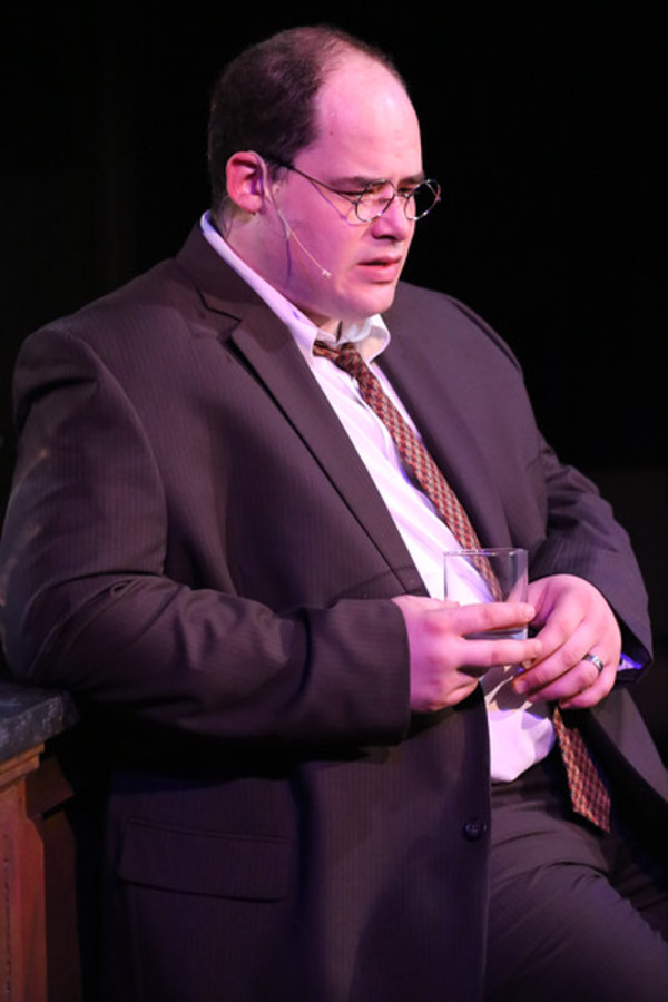 "Zachary Allen Farmer as Leo Szilard, singing ""The Atom Bomb is Here,"" in New Line Theatre's ATOMIC. Photo credit: Jill Ritter Lindberg."