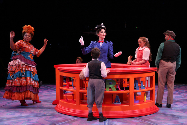 Jenelle A. Robinson (Mrs. Corry), Kerry Conte (Mary Poppins), and Brad Bradley (Bert) with Scarlett Keene-Connole (Jane Banks) and Jake Ryan Flynn (Michael Banks) in North Shore Music Theatre''s production of MARY POPPINS playing July 12 - July 31, 2016.