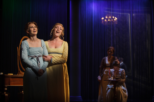 Jane Bennet (Chloe Tiso) gushes to her sister Elizabeth (Heather Botts) about the das Photo
