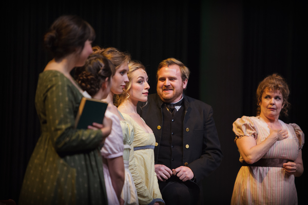 The Bennet sisters and their mother greet Mr. Collins (Zachary Tallman) as warmly as they can muster