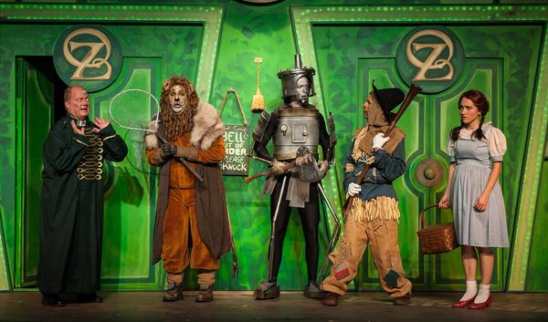 The Gatekeeper (Alan Payne) tells The Lion (Brian C. Rosenthal), The Tin Man (Matt Re Photo