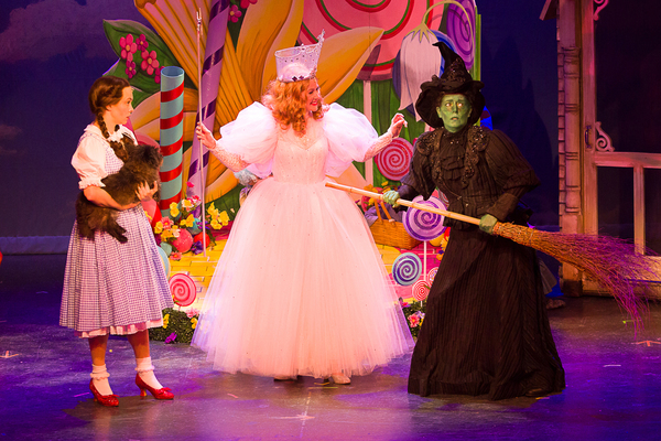 Devon Perry (Dorothy), Dusty (Toto), Rochelle Smith (Glinda), and Maria Day (The Wicked Witch of the West)