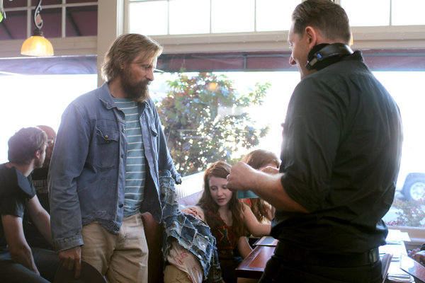 Left to right, Actors Viggo Mortensen, Charlie Shotwell, Samantha Isler and Director Matt Ross discuss a scene on the set of their film CAPTAIN FANTASTIC, a Bleecker Street release.Credit: Erik Simkins / Bleecker Street