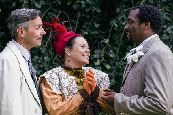Ross Shirley as Sir Robert Chiltern, with (from left to right) Sonda Staley as Lady C Photo