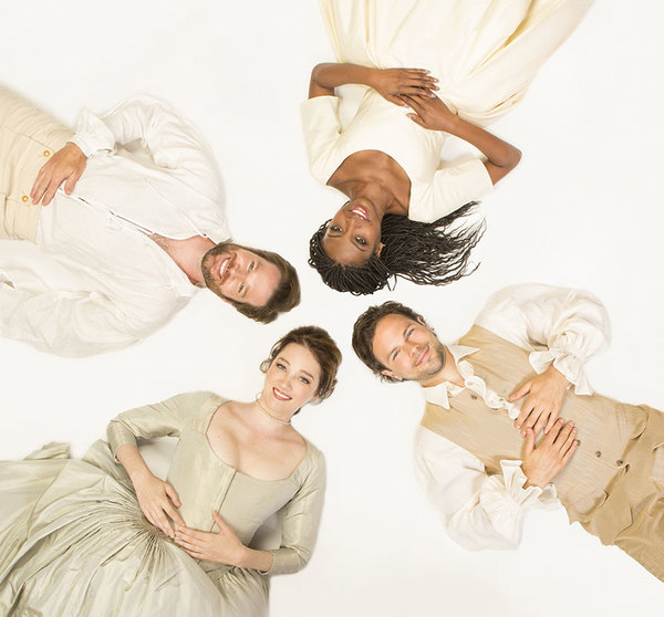 (from bottom left, clockwise) Kristen Connolly appears as the Princess of France, Kieran Campion as Berowne, Pascale Armand as Rosaline, and Jonny Orsini as Ferdinand, King of Navarre