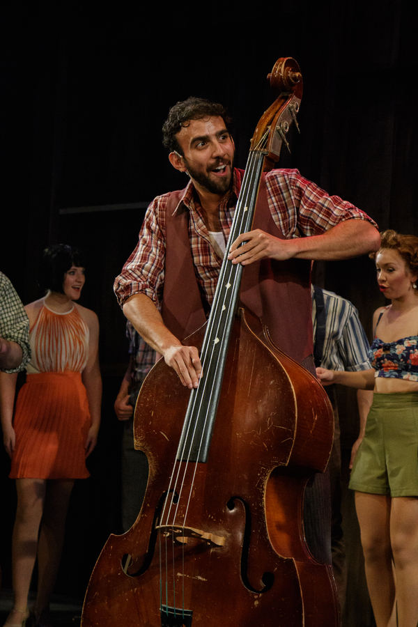 Lethargic cowboy Moose (Charles South) finds energy in the rhythm of his bass