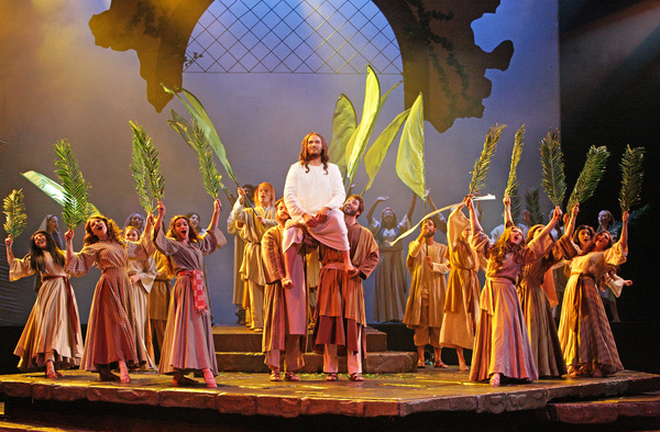 The company of JESUS CHRIST SUPERSTAR sings 'Hosanna' to Jesus (Thaddeus Pearson). Photo Credit: Christopher Clark
