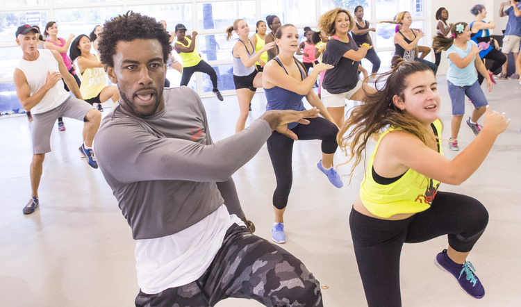 High Res J Marcos, dancer and founder of pop-hip hop dance-fitness class Videosync, leads a warm up in a jam-packed sample class.