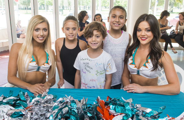 The Miami Dolphins Cheerleaders took pictures and signed autographs with visitors to the Open House.