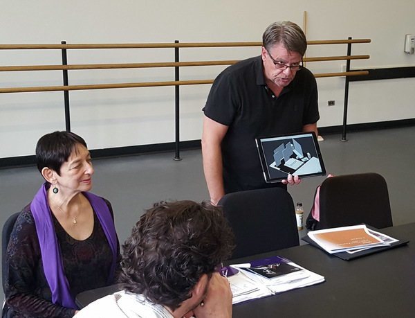 Chad McArver discussing scene design with Jane Kosminsky, and company