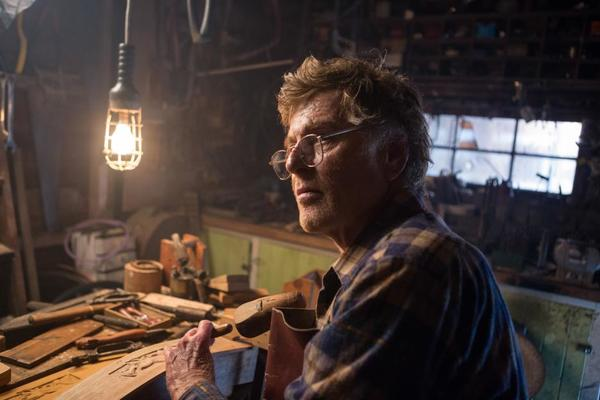 Robert Redford is Mr. Meacham, an old wood carver who is fond of telling tales about big, furry green dragons in Disney's PETE'S DRAGON, the story of a boy named Pete and his best friend Elliot, who just happens to be a dragon.