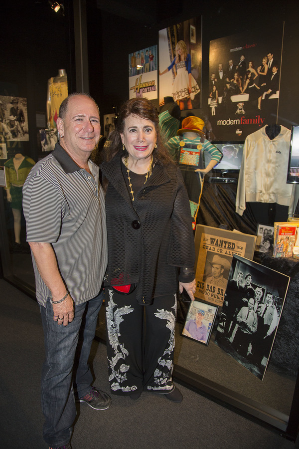 Larry Mathew (Ritchie Petrie/The Dick Van Dyke Show) and Donelle Dadigan (Founder and President of The Hollywood Museum) stand next to items on loan from Mr Mathews
