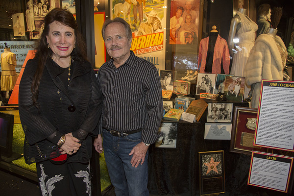 Donelle Dadigan and Jon Provost (Timmy Martin/Lassie) pose with items in exhibit