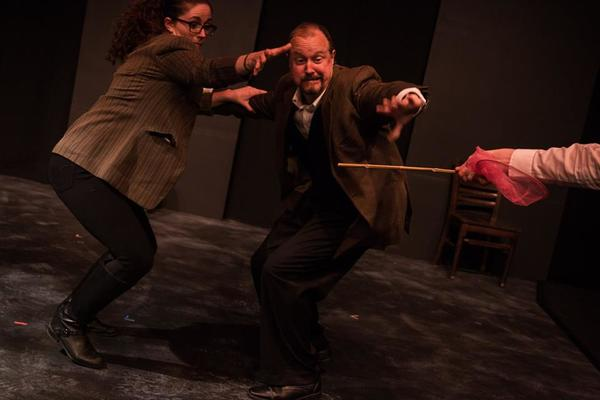 """(L to R) KAYLA CRAWFORD (Dr. Watson), GARY CHAMBERS (Sir Henry) and JACOB TICE'S HAND (Stapleton) from the Lakewood Playhouse Production of """"The 3 Person Comedic HOUND OF THE BASKERVILLES"""""""
