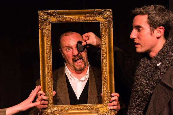 """(L to R) KAYLA CRAWFORD'S HAND (Dr. Watson), GARY CHAMBERS (as a a Baskerville as Stapleton) and JACOB TICE (Sherlock Holmes) from the Lakewood Playhouse Production of """"The 3 Person Comedic HOUND OF THE BASKERVILLES"""""""