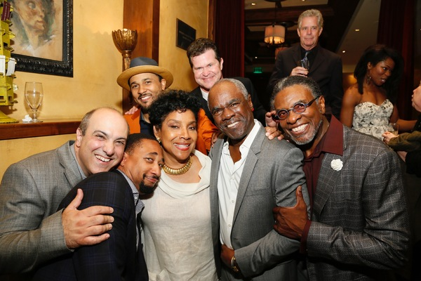 Director Phylicia Rashad (center left) and the cast