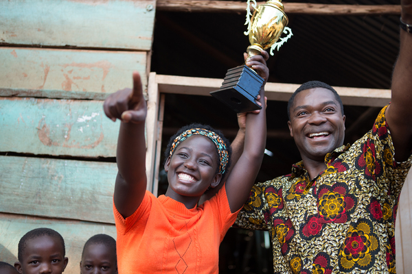 David Oyelowo is Robert Katende and Madina Nalwanga is Phiona Mutesi in in Disney's QUEEN OF KATWE, based on a true story of a young girl from the streets of rural Uganda whose world rapidly changes when she is introduced to the game of chess. Oscar (TM)