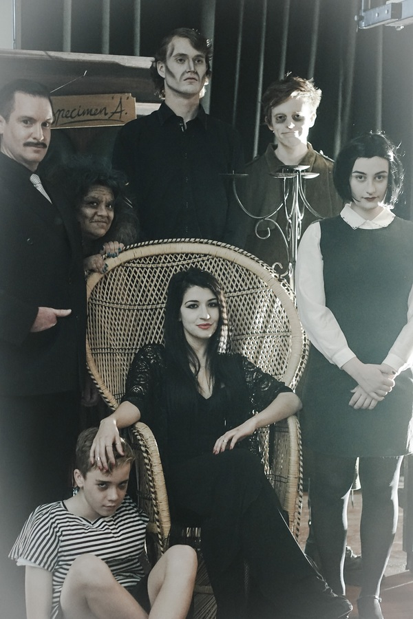 The Addams Family featrures Paul Reed, left, as Gomez, Ruby Reye (Grandma), Charlie Martin (Pugsley), Declan Roden (Lurch), Holly Denton (Morticia), Callum Siegmund (Uncle Fester) and Olivia McGavock (Wednesday). Picture: Bethsaida Ellayne