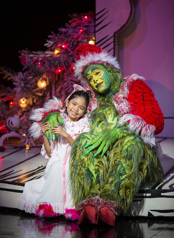 """Mikee Castillo as Cindy-Lou Who and J. Bernard Calloway as The Grinch in Dr. Seuss' How the Grinch Stole Christmas!, directed by James Vásquez, running Nov. 5 â€"""" Dec. 26, 2016 at The Old Globe. Photo by Jim Cox."""
