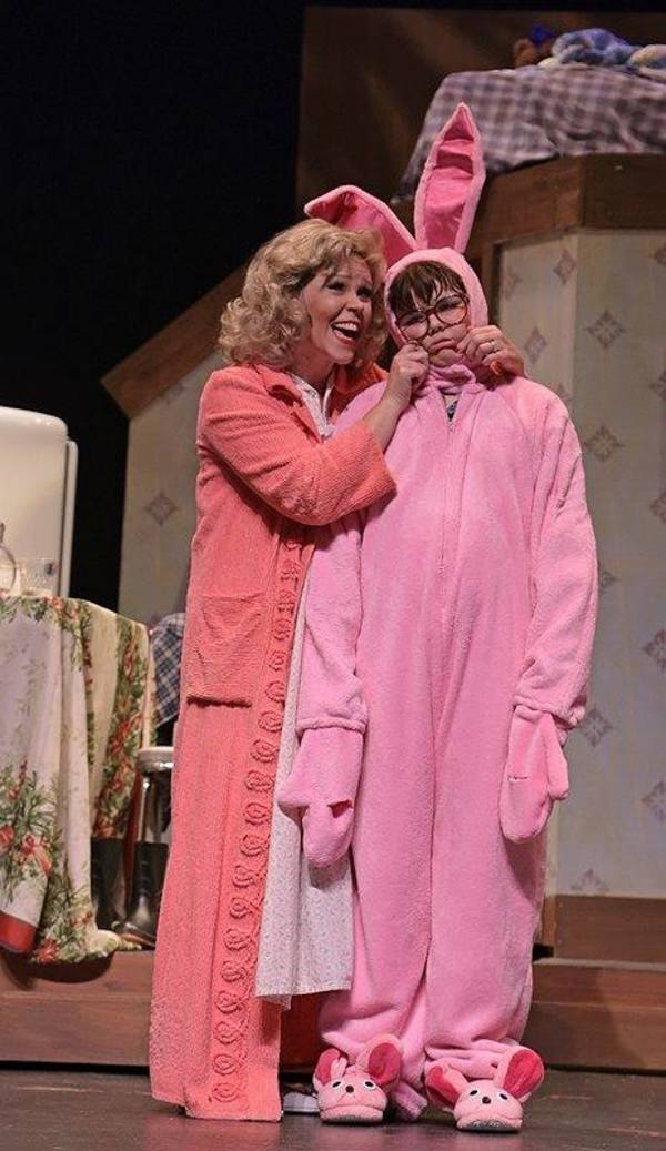 tyler sautner shows off his aunt claras bunny suit to his mother jennifer grasso in phoenix productions november revival of a christmas story