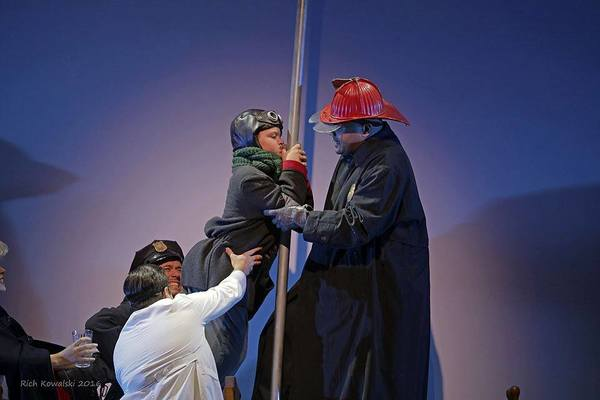 "It's a ""sticky situation� for poor Flick (played by Carl Smith) as the townspeople attempt to unstick his tongue in this famous flagpole scene in Phoenix Productions' November revival of A Christmas Story."